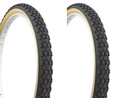 pair of knobby bicycle bike tires gum